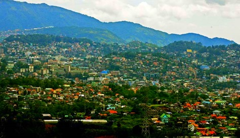 BAGUIO AT 104. Baguio, which has a land area of 57 square-kilometers and designed for 25,000 people, is now home to close to 400,000 people and has grown to become one of the highly urbanized cities in the country. Baguio celebrates its 104th Charter Day anniversary on September 1. 010913_baguio_05_comanda.jpg.</p> <p>